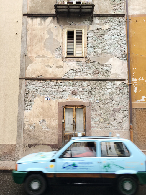 Speedy cars and textures on the streets of Bosa, Italy